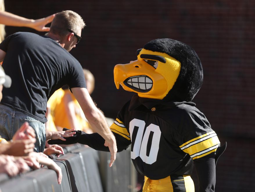 In a Saturday, Sept. 6, 2014 photo, Herky meets with fans during the Ball State game, at Kinnick Stadium in Iowa City, Iowa. (AP Photo/The Des Moines Register, Bryon Houlgrave)