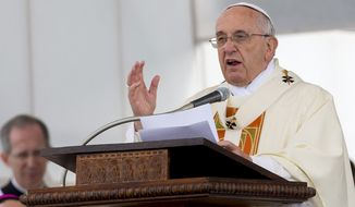 "Pope Francis delivers his message during an open-air mass in front of the Italy's largest war memorial, in Fogliano Redipuglia, northern Italy, Saturday, Sept. 13, 2014. Pope Francis has urged the world to shed its apathy in the face of what he sees as a third world war, intoning ""war is madness"" during a homily at the foot of a Fascist-era World War I monument near the Slovene border. (AP Photo/Paolo Giovannini)"