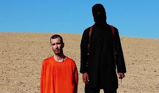 This image made from video posted on the Internet by Islamic State militants and provided by the SITE Intelligence Group, a U.S. terrorism watchdog, on Saturday, Sept. 13, 2014, purports to show British aid worker David Haines before he was beheaded. (Associated Press)