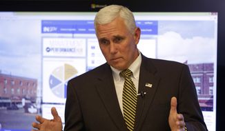 Indiana Gov. Mike Pence answers questions on Sept. 9, 2014, about the new Management & Performance Hub, a new management office, that was unveiled at the Statehouse in Indianapolis. (Associated Press) **FILE**