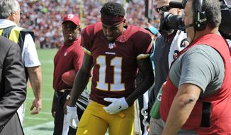 Washington Redskins wide receiver DeSean Jackson (11) walks off the field after he was injured during the first half of an NFL football game against the Jacksonville Jaguars Sunday, Sept. 14, 2014, in Landover, Md. (AP Photo/Nick Wass)