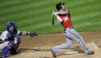 Washington Nationals' Bryce Harper (34) hits a two-run home run off of New York Mets starting pitcher Zack Wheeler as Travis d'Arnaud catches for the Mets in the  second inning of a baseball game at Citi Field on Saturday, Sept. 13, 2014, in New York. (AP Photo/Kathy Kmonicek)