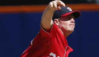 Washington Nationals starting pitcher Jordan Zimmermann throws during the first inning of a baseball game against the New York Mets on Sunday, Sept. 14, 2014, in New York. (AP Photo/Seth Wenig)