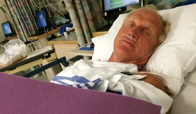This photo provided by Greg Norman shows Norman resting in a hospital bed after a chainsaw accident.  Norman posted a photo to Instagram on Sunday, Sept. 14, 2014,  in which he was laying in a hospital bed with his left arm  heavily bandaged.  The Hall of Fame golfer and entrepreneur, was cutting back trees in his South Florida home when the weight of a branch pulled his left hand toward the chain saw. He said the blade hit him just below where a person would be wearing a wrist watch. He said doctors told him it missed his artery by a fraction of an inch. (AP Photo/Courtesy of Greg Norman)