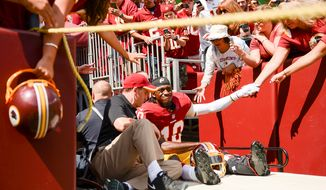 Washington Redskins quarterback Robert Griffin III (10) is carted off the field after injuring his leg in the first quarter as the Washington Redskins play the Jacksonville Jaguars at FedExField, Landover, Md., Monday, September 9, 2013. (Andrew Harnik/The Washington Times)
