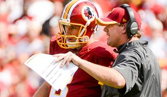 Washington Redskins head coach Jay Gruden talks with Washington Redskins quarterback Kirk Cousins (8) as he takes the field at the end of the 1st half as the Washington Redskins play the Jacksonville Jaguars at FedExField, Landover, Md., Monday, September 9, 2013. (Andrew Harnik/The Washington Times)