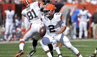 Cleveland Browns quarterback Johnny Manziel (2) rolls away from pressure in the third quarter of an NFL football game against the New Orleans Saints Sunday, Sept. 14, 2014, in Cleveland. (AP Photo/David Richard)