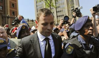 Oscar Pistorius leaves court in Pretoria, South Africa, Friday, Sept. 12, 2014.  In passing judgement judge Thokozile Masipa  ruled out a murder conviction for the double-amputee Olympian in the shooting death of his girlfriend, Reeva Steenkamp,  but said he was negligent and convicted him of culpable homicide. Sentencing procedures will start Oct. 13. (AP Photo)