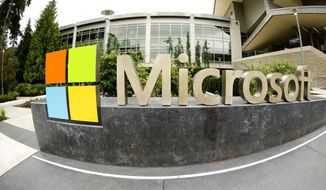 Microsoft will acquire Stockholm-based game maker Mojang, the maker of the popular game Minecraft for $2.5 billion, the company announced Monday, Sept. 15, 2014. Microsoft Corp. signage is shown outside the Microsoft Visitor Center in Redmond, Wash. (AP Photo Ted S. Warren, File)