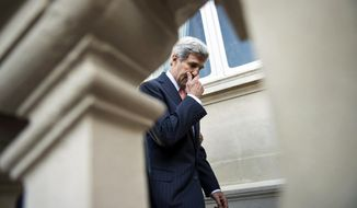 US Secretary of State John Kerry  leaves after a family photo at the conference intended to come up with an international strategy against  Islamic State extremists in Paris, Monday, Sept. 15, 2014. As diplomats from around the world sought a global strategy to fight Islamic State extremists, Iran ruled out working with any international coalition, saying it had rejected American requests for cooperation against the militants. (AP Photo/Brendan Smialowski; Pool)