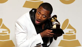 """Lecrae says, """"There's just limited perspective in hip-hop outside of money, cars, girls and so on and so forth."""" Released last week, his 15-song collection already has shot to No. 1 on iTunes and is expected to top the Billboard 200 chart Wednesday. (Invision via Associated Press)"""