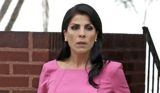 Jill Kelley leaves her home in Tampa, Fla., in this Nov. 13, 2012, file photo. U.S. District Judge Amy Berman Jackson says Jill Kelley can press her claim that the FBI and Defense Department violated her privacy when officials allegedly leaked information about her to the news media. Berman also tossed out more than a dozen other claims of government wrongdoing. (AP Photo/Chris O'Meara, File)