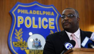 Homicide Capt. James Clark speaks during a news conference about the shooting of 25-year-old Megan Doto in Philadelphia, Monday, Sept. 15, 2014. (AP Photo/Matt Rourke) ** FILE **