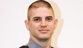 This photo provided by the Pennsylvania  State Police shows Cpl. Byron Dickson. Dickson was killed by a gunman as he left the police barracks in Blooming Grove, Pa. State police spokesman Trooper Tom Kelly said investigators hope to soon interview Trooper Alex Douglass, who was injured in the attack, to get additional information on the ambush. (AP Photo/Pennsylvania  State Police)
