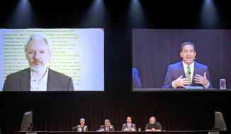 WikiLeaks founder Julian Assange, top left, appears via video link from London as international human rights lawyer Laila Harre, bottom left, Robert Amsterdam, second left, journalist and author Glenn Greenwald, second right and projected top right, and Kim Dotcom, right, attend a political forum at a town hall in Auckland, New Zealand, Monday, Sept. 15, 2014. (AP Photo/New Zealand Herald, Brett Phibbs) ** FILE **