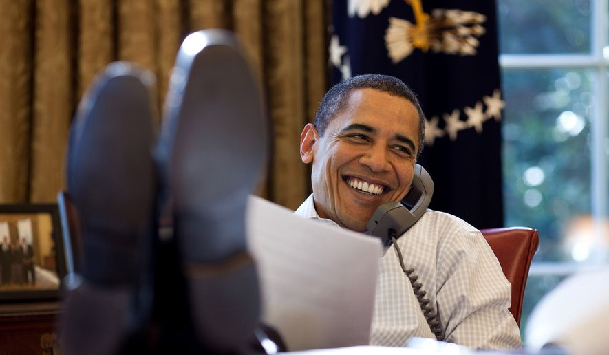 President Barack Obama smiles while talking on the phone in the Oval Office, Saturday, Dec. 12, 2009. (Official White House Photo by Pete Souza)