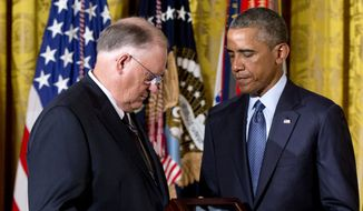 President Barack Obama presents the Medal of Honor for Army Spc. Donald P. Sloat to his brother William Sloat, left, in the East Room of the White House in Washington, Monday, Sept., 15, 2014. Donald P. Sloat of Coweta, Okla., was killed in action on Jan. 17, 1970, at age 20. While on patrol, a soldier in his squad triggered a hand grenade trap that had been placed in their path by enemy forces. According to the White House, Sloat picked up the live grenade, initially to throw it away. When he realized it was about to detonate, he shielded the blast with his own body in order to save the lives of his fellow soldiers. (AP Photo/Carolyn Kaster)