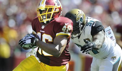 Washington Redskins running back Alfred Morris (46) races for a first down in front of Jacksonville Jaguars defensive end Chris Clemons (91) in the second quarter  at FedEx Field, Sept. 14, 2014. (Preston Keres/Special for The Washington Times)