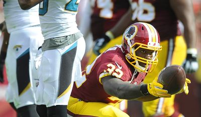 Washington Redskins running back Silas Redd (32) celebrates a first down run against the Jacksonville Jaguars at FedEx Field, Sept. 14, 2014. (Preston Keres/Special for The Washington Times)
