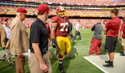 Washington Redskins guard Shawn Lauvao (77) comes off the field after being injured as the Washington Redskins play the Jacksonville Jaguars at FedExField, Landover, Md., Monday, September 9, 2013. (Andrew Harnik/The Washington Times)