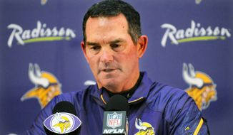 Minneosta Vikings head coach Mike Zimmer speaks at a news conference at the team's training facility in Eden Prairie on Monday, Sept. 15, 2014.  The Vikings announced Monday that running back Adrian Peterson will return to practice this week and play in Sunday's game at New Orleans despite having been indicted last week in Texas on a charge of reckless or negligent injury to a child.     (AP Photo/The St. Paul Pioneer Press, Scott Takushi)  MINNEAPOLIS STAR TRIBUNE OUT