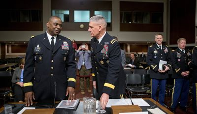 Gen. Lloyd J. Austin III (left), commander of the U.S. Central Command, had wanted to be more aggressive in using ground troops in Iraq but did not win his superiors' or the White House's OK. (Associated Press)