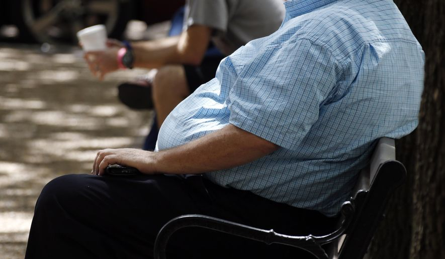 In this Thursday, Sept. 4, 2014, file photo, an overweight man rests on a bench in Jackson, Miss. (AP Photo/Rogelio V. Solis, File)