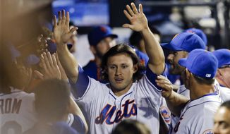 New York Mets' Matt den Dekker celebrates with teammates after scoring on a Ruben Tejada double during the fourth inning of a baseball game Tuesday, Sept. 16, 2014, in New York. (AP Photo/Frank Franklin II)