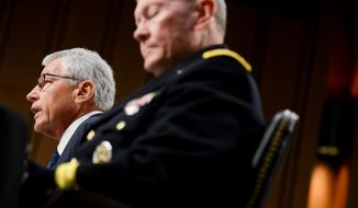 Secretary of Defense Chuck Hagel, left, and the Chairman of the Joint Chiefs of Staff Martin Dempsey testify concerning the Islamic State of Iraq and the Levant (ISIL) in front of the Senate Armed Services Committee on Capitol Hill, Washington, D.C., Tuesday, September 16, 2014. (Andrew Harnik/The Washington Times)