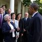 President Barack Obama jokes with Environmental Protection Agency Administrator Gina McCarthy and EPA staff members who worked on the power plant emissions standards, in the Rose Garden of the White House, June 2, 2014. (Official White House Photo by Pete Souza)