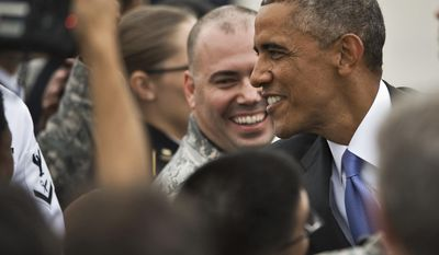 President Obama, right, greets military personnel as he arrives at MacDill Air Force Base for meetings at Central Command, Tuesday, Sept. 16, 2014 in Tampa, Fla. (AP Photo/Steve Nesius)