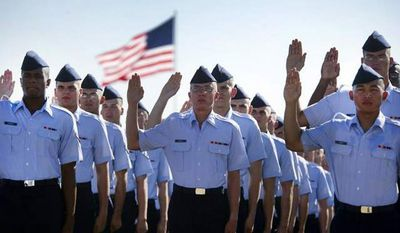 Airmen repeat the oath of enlistment at the Air Force Basic Training graduation ceremony, Lackland Air Force Base, Texas (U.S. Air Force, Staff Sgt Vernon Young Jr.)