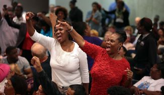 """Ferguson protesters chant """"Arrest Darren Wilson!"""" during at a meeting of the St. Louis County Council on Tuesday, Sept. 16, 2014 in Clayton. (AP Photo/St. Louis Post-Dispatch, Robert Cohen)"""