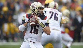 Maryland quarterback C.J. Brown (16) looks to pass against West Virginia during the second half of an NCAA football game, Saturday, Sept. 13, 2014, in College Park, Md. West Virginia won 40-37. (AP Photo/Nick Wass)
