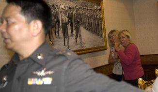 Family members of Hannah Witheridge, one of two slain British tourists, cry at the Royal Thai Police Headquarters before meeting with Thai police in Bangkok, Thailand, Thursday, Sept. 18, 2014. Police in Thailand said Wednesday that DNA samples from the bodies of two British tourists found bludgeoned on a resort island did not match any collected from 12 people who were among those in the area.(AP Photo/Sakchai Lalit)