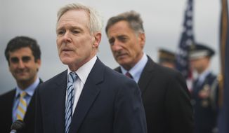 Secretary of the Navy Ray Mabus, foreground, flanked by Burlington Mayor Miro Weinberger, left, and Vermont Gov. Peter Shumlin, announces the naming of a fast-attack submarine after the state of Vermont during a ceremony Thursday, Sept. 18, 2014, in Burlington, Vt. The USS Vermont is the first U.S. Navy vessel to be named after the Green Mountain State in more than 100 years. (AP Photo/Burlington Free Press, Ryan Mercer) NO SALES; MANDATORY CREDIT; TV OUT; INTERNET OUT
