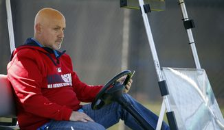Washington Nationals general manager Mike Rizzo watches during a spring training baseball workout, Monday, Feb. 17, 2014, in Viera, Fla. (AP Photo/Alex Brandon)