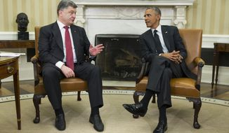 President Barack Obama, right, meets with Ukrainian President Petro Poroshenko in the Oval Office of the White House on Sept. 18, 2014. (Associated Press) **FILE**