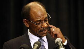 Former Texas Rangers manager Ron Washington looks down at the podium as he makes a statement at a news conference, Thursday, Sept. 18, 2014, in Irving, Texas. (AP Photo/Tony Gutierrez)