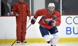 Washington Capitals defenseman Brooks Orpik (44) skates during a drill at NHL hockey training camp, Friday, Sept. 19, 2014, in Arlington, Va. (AP Photo/Nick Wass)