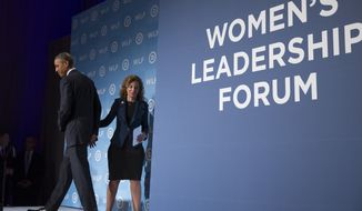 Democratic National Committee Chairwoman Rep. Debbie Wasserman Schultz, D-Fla., right, introduces President Barack Obama to make remarks at the Democratic National Committee's Women's Leadership Forum, on Friday, Sept. 19, 2014, in Washington. (AP Photo/Evan Vucci)