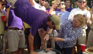Sen. Mary Landrieu was spotted pouring beer into the mouth of a Louisiana State University fan who was doing a keg stand during a tailgating event on Saturday. (Twitchy)