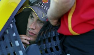 Driver Joey Logano sits in his car before qualifying at NASCAR Sprint Cup auto race at New Hampshire Motor Speedway, in Loudon, N.H., Friday, Sept. 19, 2014 (AP Photo/Cheryl Senter)