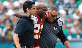 Washington Redskins' DeAngelo Hall is helped off the field after an injury during the second half of an NFL football game against the Philadelphia Eagles, Sunday, Sept. 21, 2014, in Philadelphia. (AP Photo/Matt Rourke)