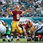 Washington Redskins' Kirk Cousins calls a play during the second half of an NFL football game against the Philadelphia Eagles, Sunday, Sept. 21, 2014, in Philadelphia. (AP Photo/Matt Rourke)