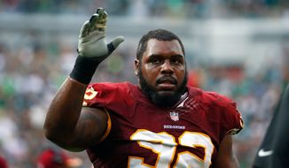 Washington Redskins' Chris Baker walks off the field after being disqualified during the second half of an NFL football game against the Philadelphia Eagles, Sunday, Sept. 21, 2014, in Philadelphia. (AP Photo/Matt Rourke)