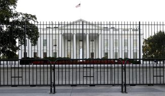 The perimeter fence sits in front of the White House fence on the North Lawn along Pennsylvania Avenue in Washington, in this Monday, Sept. 22, 2014, file photo. (AP Photo/Carolyn Kaster) ** FILE **