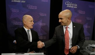 California Gov. Jerry Brown (left) shakes hands with Republican challenger Neel Kashkari before a gubernatorial debate in the state capital of Sacramento. (Associated Press)