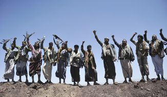 Hawthi Shiite rebels chant slogans at the compound of the army's First Armored Division, after they took it over, in Sanaa, Yemen, Monday, Sept. 22, 2014. Heavily armed Yemeni Shiite militiamen took over the headquarters and house of a powerful army general allied to Sunni Islamists on Monday and set up checkpoints across the capital, Sanaa, after sweeping across the city as the general and his allies fled and went into hiding. (AP Photo/Hani Mohammed)