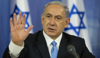 In this Aug. 2, 2014, file photo, Israeli Prime Minister Benjamin Netanyahu speaks during a news conference at the defense ministry in Tel Aviv, Israel. (AP Photo/Oded Balilty, File)